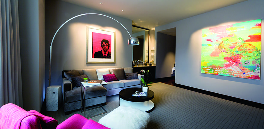 Russell Young's Elvis Presley Mugshot Pink and David Kramer's Working the Social Network in Conrad Indianapolis' Contemporary Suite