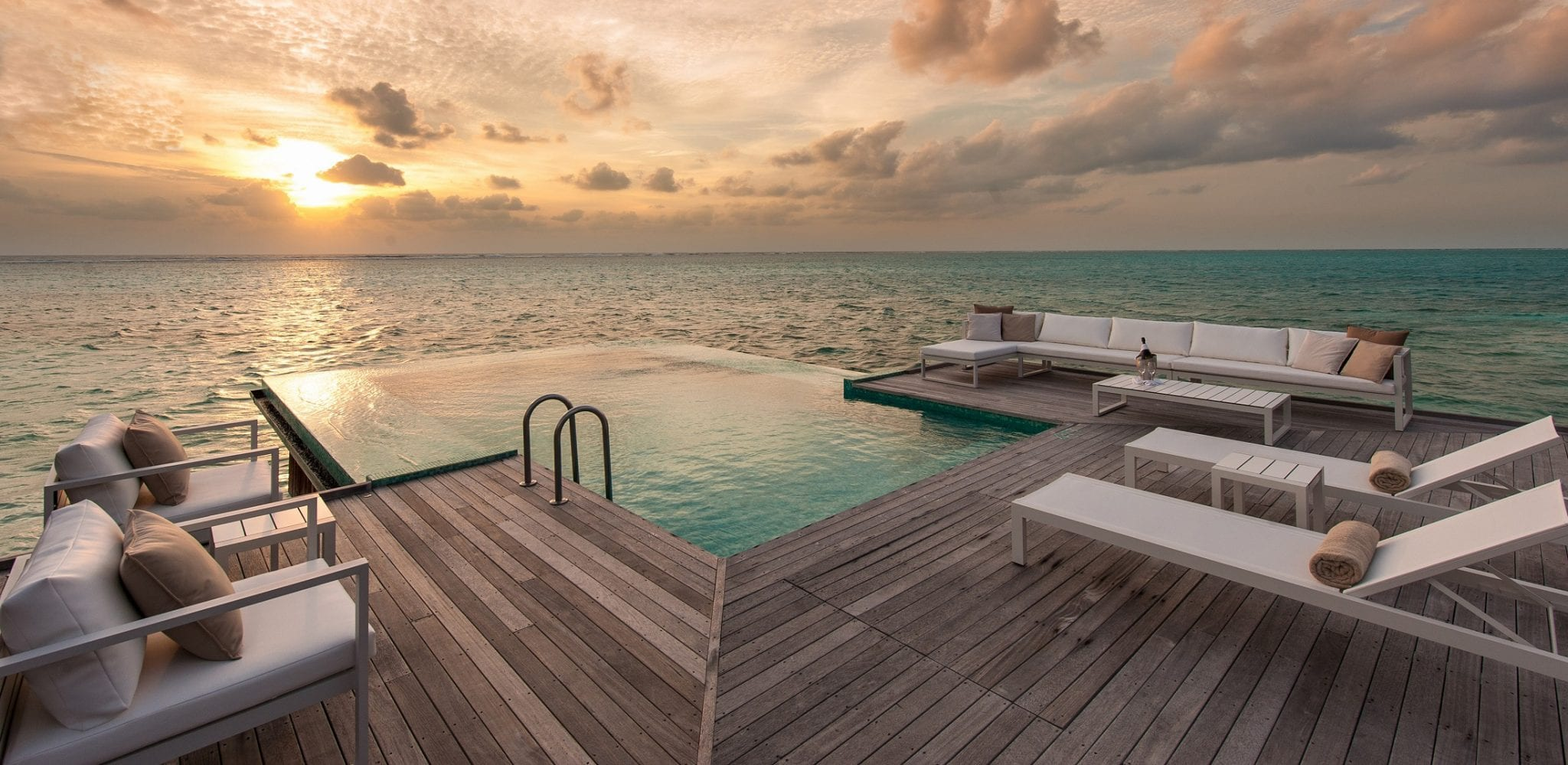 Over-the-water infinity pool at Conrad Maldives Rangali Island